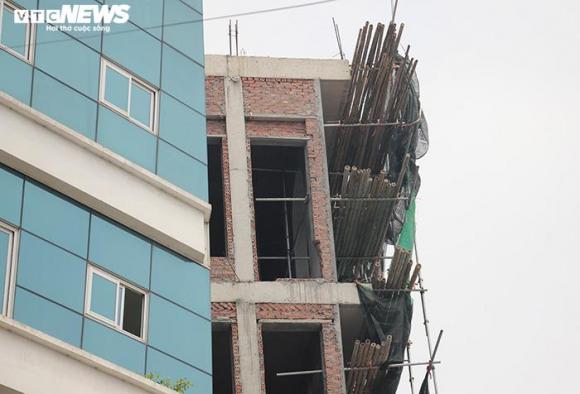 Hai tòa nhà của Đường 'Nhuệ' vi phạm trật tự xây dựng, vẫn đứng sừng sững - 9