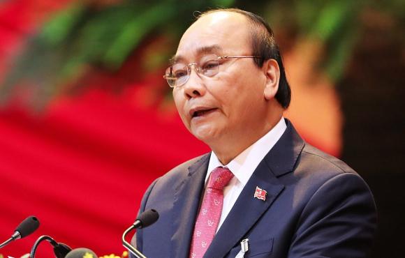 Uỷ viên Bộ Chính trị, Thủ tướng Nguyễn Xuân Phúc phát biểu khai mạc Đại hội XIII. Ảnh: Giang Huy