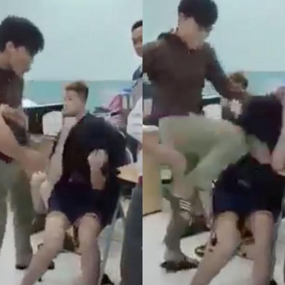 Bảo vệ dân phố đánh hai thiếu niên tại Trường THCS Nguyễn Văn Tố, P.14, Q.10, TP.HCM /// Ảnh cắt từ clip