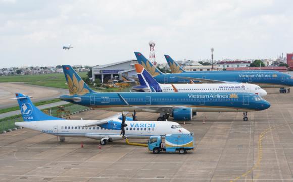 Vietnam Airlines: Lỗ hơn 11.000 tỷ, Ban lãnh đạo nhận ᴛнù ʟao 6,5 tỷ đồng - Ảnh 3.